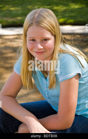 11 to 13 year old children young person people Teenage Junior high age Caucasian girl smiling camera.United States - Stock Photo
