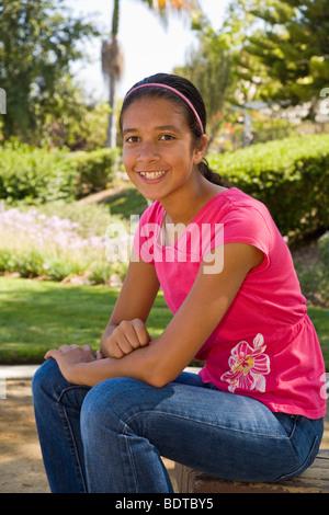 Hispanic junior high age girl smiling at camera. MR  © Myrleen Pearson - Stock Photo