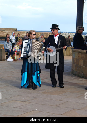 Whitby Folk Festival. Two musicians in costume playing - Stock Photo