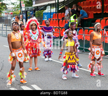 Children performing at The Notting Hill Carnival in London - Stock Photo