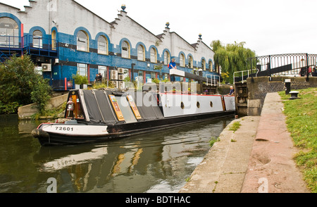 A barge exiting a lock, Regent's Canal, Camden, London - Stock Photo