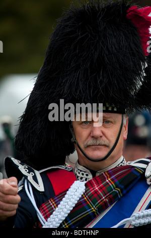 Scottish Pipe band Drum Major Braemar Royal Highland Gathering & Games at the princess Royal & Duke of Fife Memorial - Stock Photo