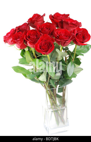 Red roses in a glass vase isolated - Stock Photo