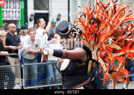 A performer at The Notting Hill Carnival in London - Stock Photo