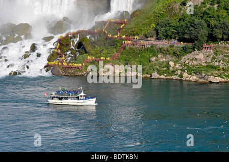 Maid of the Mist boat with tourists, Niagara Falls, Canada - Stock Photo