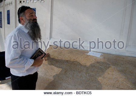Sephardic religious Jew praying at the tomb of Rabbi Moses Ben-Maimon, known  as Maimonides or Rambam in Tiberias - Stock Photo