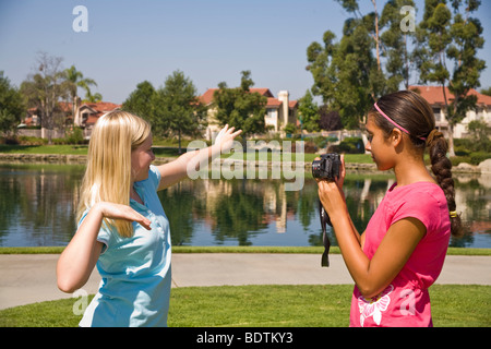 United States Two Racially mixed mix Ethnic diversity girls hang hanging out together.Hispanic junior high girl - Stock Photo