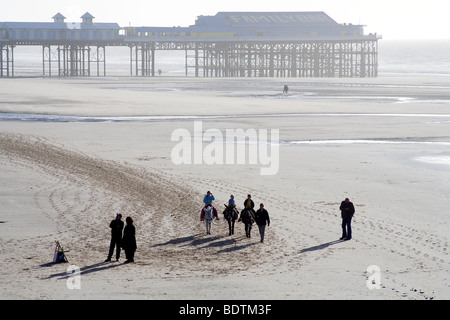 Donkey rides on Blackpool beach - Stock Photo