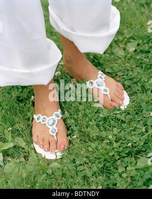 Feet wearing sandals - Stock Photo