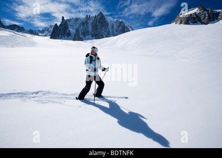 Skier going downhill Chamonix France. - Stock Photo