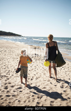 Mother and son walking on the beach Gotland - Stock Photo