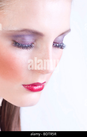 young woman, with artificial eyelid - Stock Photo