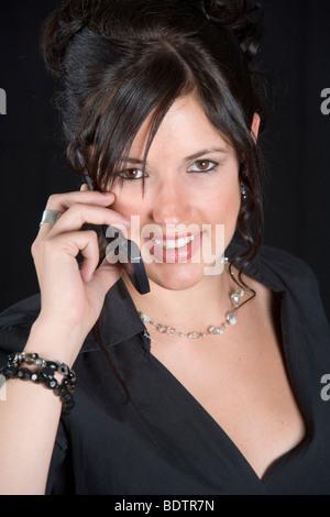 Portrait einer Frau mit Handy, woman with mobile phone - Stock Photo