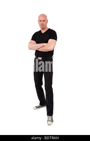 bald headed young man ,looking angry into the camera - Stock Photo