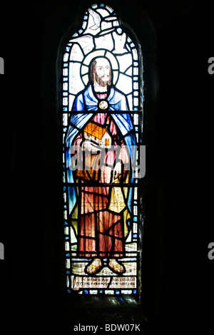 Stained glass window depicting Saint Piran, Tintagel Church, Cornwall - Stock Photo