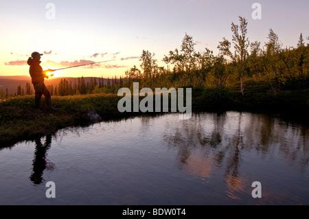 angler, midnight sun in lapland, sweden - Stock Photo