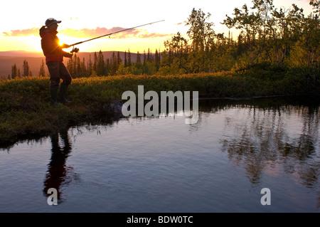 fisher, midnight sun in lapland, sweden - Stock Photo