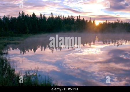 sonnenuntergang ueber see in lappland, schweden, lake at sunset in lapland, sweden - Stock Photo