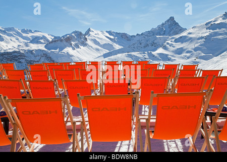 Sun loungers, Courchevel 1850 ski resort, Three Valleys, Les Trois Vallees, Savoie, French Alps, France - Stock Photo