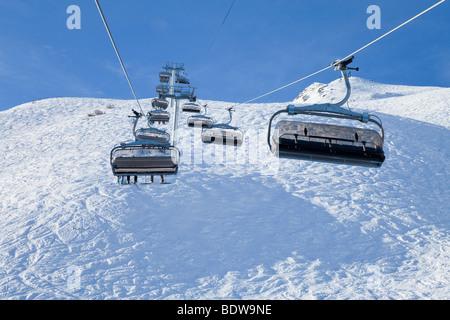 Chairlift, Meribel ski resort (1450m) in the Three Valleys, Les Trois Vallees, Savoie, French Alps, France - Stock Photo