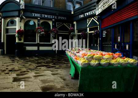 Colourful Fruit and veg stall in the Seven Sisters Rd Finsbury Park after a shower of rain. - Stock Photo