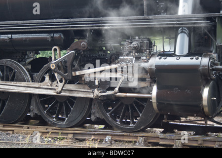 Driving motion of a Lima 2-8-0 Class S160 locomotive, including cylinder, piston rod and valve gears - Stock Photo