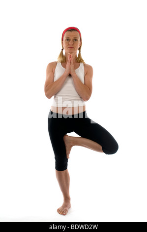 yoga tree pose tree pose exercise fitness stretch stretching fit woman lady middle age pretty attractive old older - Stock Photo