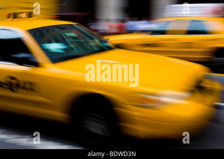 Taxi driving, Manhattan, New York City, USA - Stock Photo