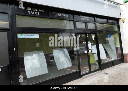 Estate agent which has closed down in the recession, London, UK - Stock Photo