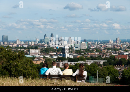 People looking at the view of London from the top of Parliament Hill on Hampstead Heath, London, England, UK - Stock Photo