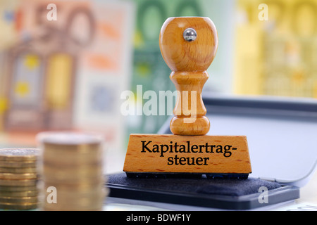 Stamp with the writing Kapitalertragsteuer capital yields tax - Stock Photo