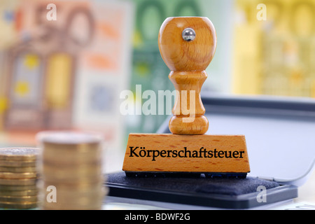 Stamp with the writing Koerperschaftsteuer, German for corporate income tax - Stock Photo