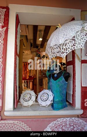 Burano Lace on display in shop, Burano island in the Venice lagoon, Venice, Veneto, Italy, Europe - Stock Photo