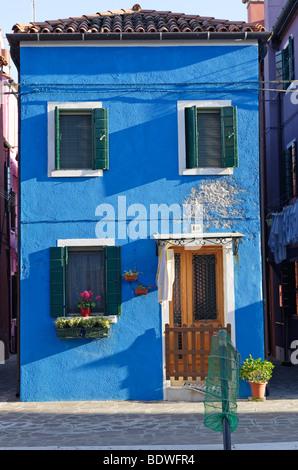 Brightly painted blue house on Burano island in the Venice lagoon, Venice, Veneto, Italy, Europe - Stock Photo