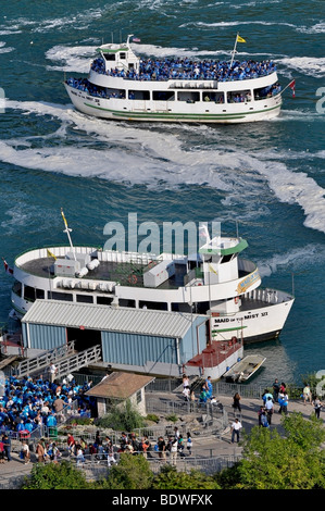 Maid of the Mist boat with Tourists - Niagara Falls, Canada - Stock Photo