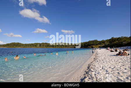 Tourists swimming in Lake McKenzie, UNESCO World Natural Heritage Site, Fraser Island, Great Sandy National Park, - Stock Photo