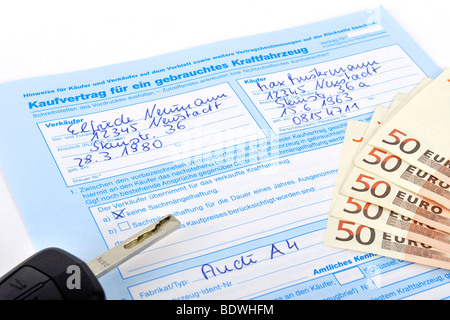 Contract of sale of a used vehicle, car - Stock Photo
