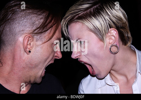 Couple screaming at each other - Stock Photo