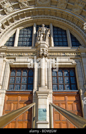 the main entrance to the victoria and albert museum, london, england, with figure of albert above the closed doors - Stock Photo