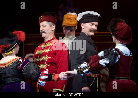 Dancers in traditional Hungarian folk costume perform at a cultural festival in Pec, Hungary - Stock Photo