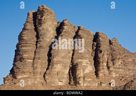 Seven Pillars of Wisdom Rock Formation in Wadi Rum Jordan - Stock Photo