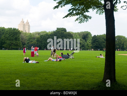 A sunny afternoon on the Great Lawn in Central Park, New York City USA - Stock Photo