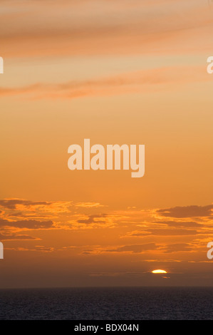Beautiful view of a sunset across the sea on the Welsh coast. - Stock Photo
