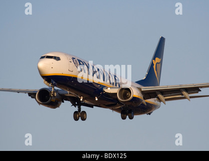 Ryanair plane. Cheap flights. Boeing 737-800 passenger jet plane belonging to low cost airline Ryanair in flight on approach. Front view close-up.