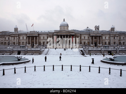 LONDON: TRAFALGAR SQUARE AND NATIONAL GALLERY IN THE SNOW - Stock Photo
