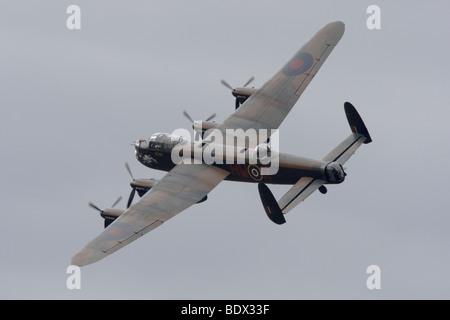 Avro 683 lancaster B1 PA474 in Flight at Duxford, Cambridgeshire, England, United Kingdom - Stock Photo