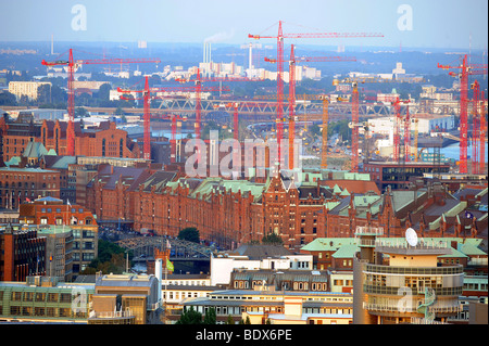 Red Cranes between the city/Hafencity and the so called Speicherstadt in Hamburg, Germany, July 30, 2008. - Stock Photo