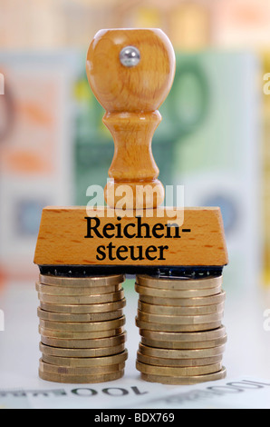 Stamp with the inscription 'Reichensteuer', German for 'tax on the rich' - Stock Photo