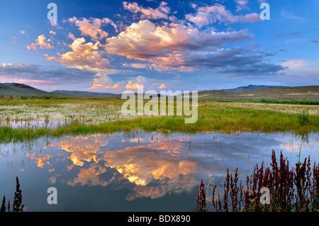 Sunset clouds over pond. Black Rock Desert National Conservation Area. Nevada - Stock Photo