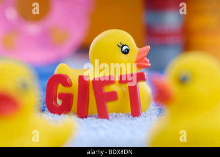 Rubber duck and writing 'gift', German for poison, poisons in rubber and plastic products - Stock Photo